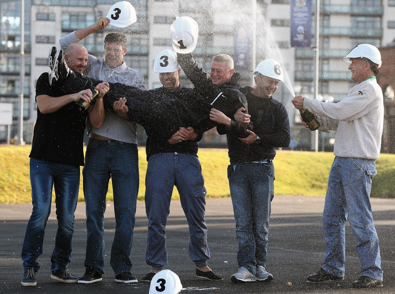 The six winners celebrate