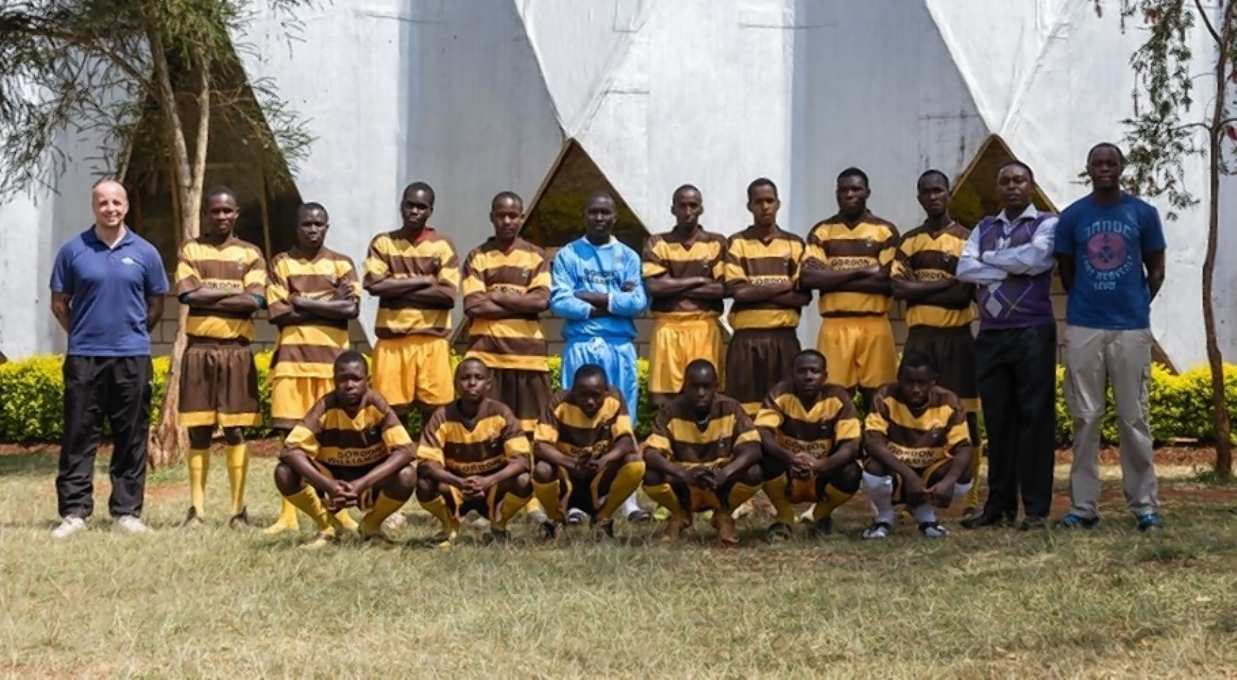 The AfriCan-Cans proudly show off their Forres strips.