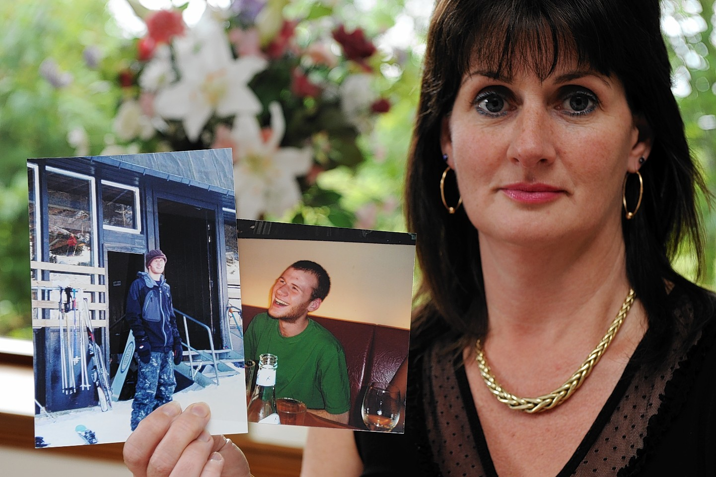 June Ross, with pictures of her son Ian Buchanan, who was killed in a crash in June 2010