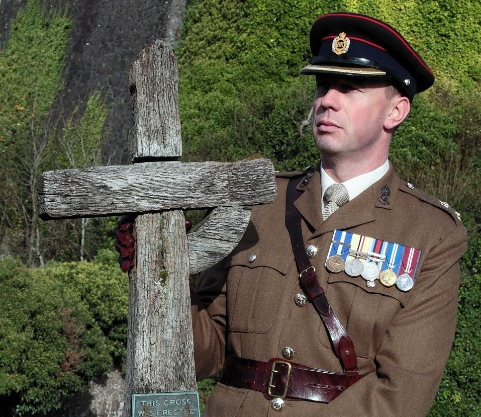 Lieutenant Colonel Tom Marsden, with the original memorial cross which was laid on the war grave of Lieutenant Mowbray in Ypres, which has been recreated.
