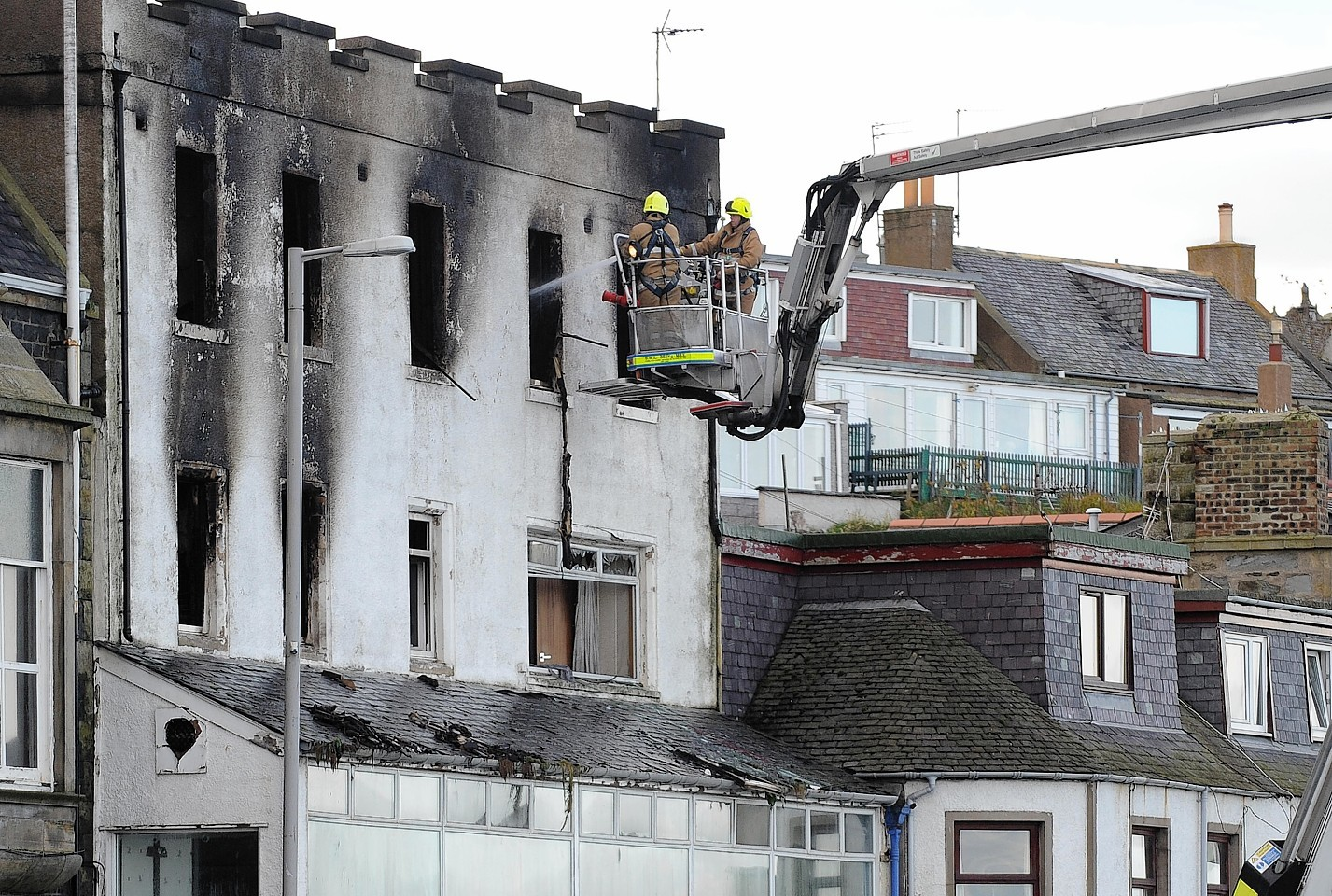 Fire crews work to make the building safe