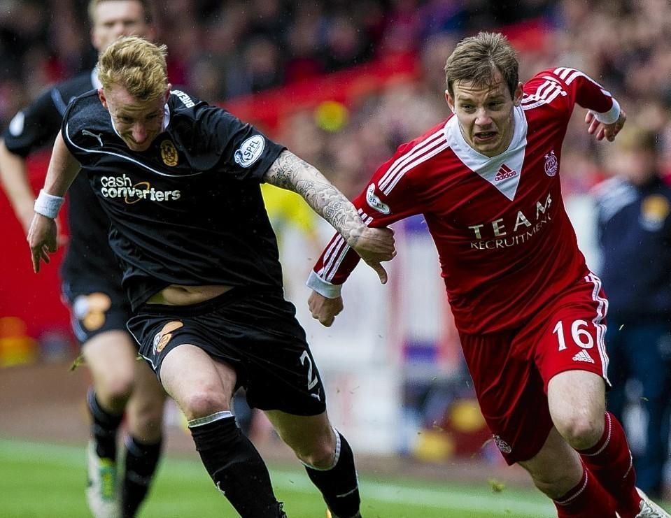 Aberdeen winger Peter Pawlett takes on  Motherwell's Craig Reid last season