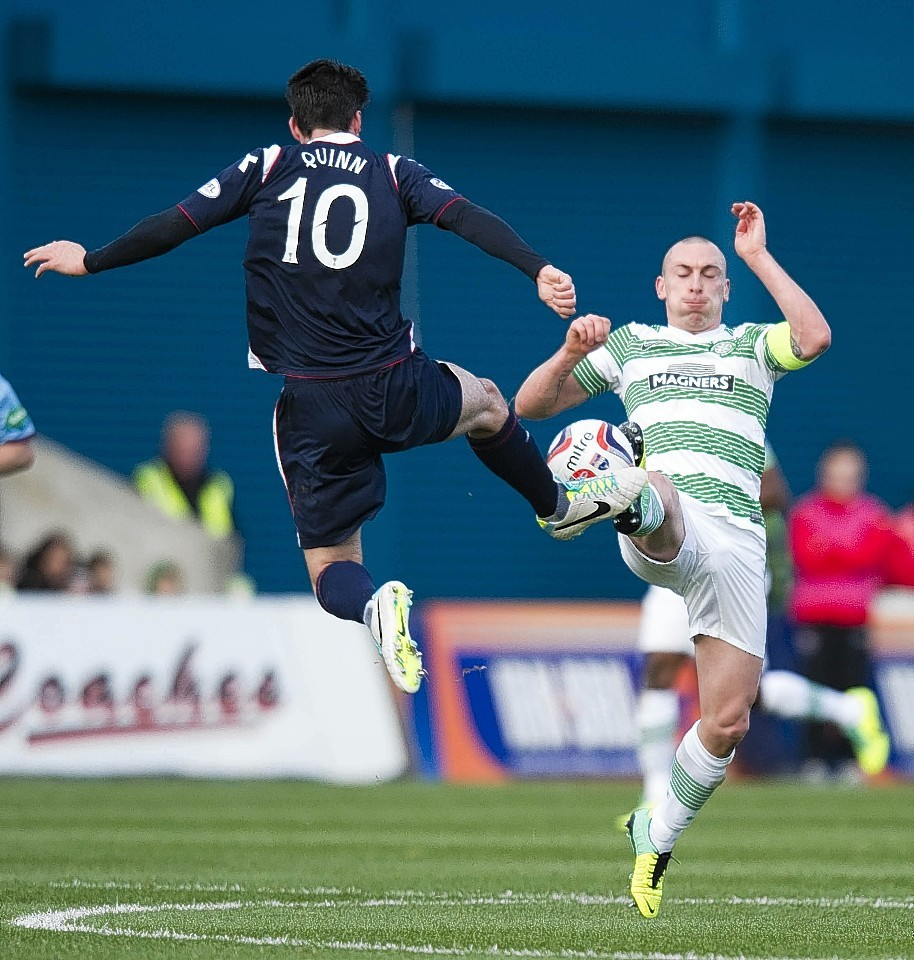 County's Rocco Quinn and Celtic captain Scott Brown challenge for the ball when the teams met last season