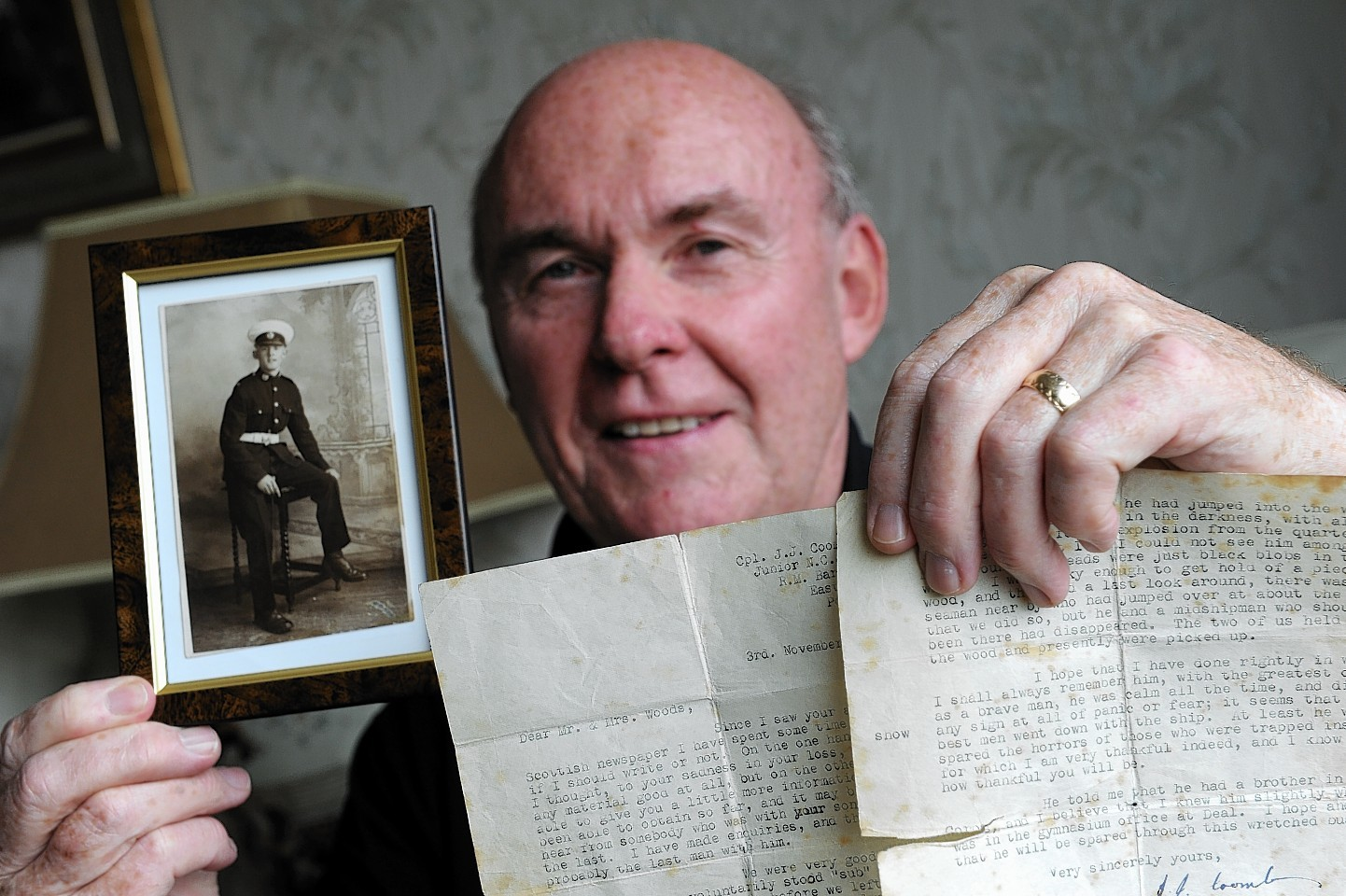 Jim Wood with a picture of his uncle William John Wood who died in the Royal Oak sinking, with a letter from the ship's captain JJ Coombes