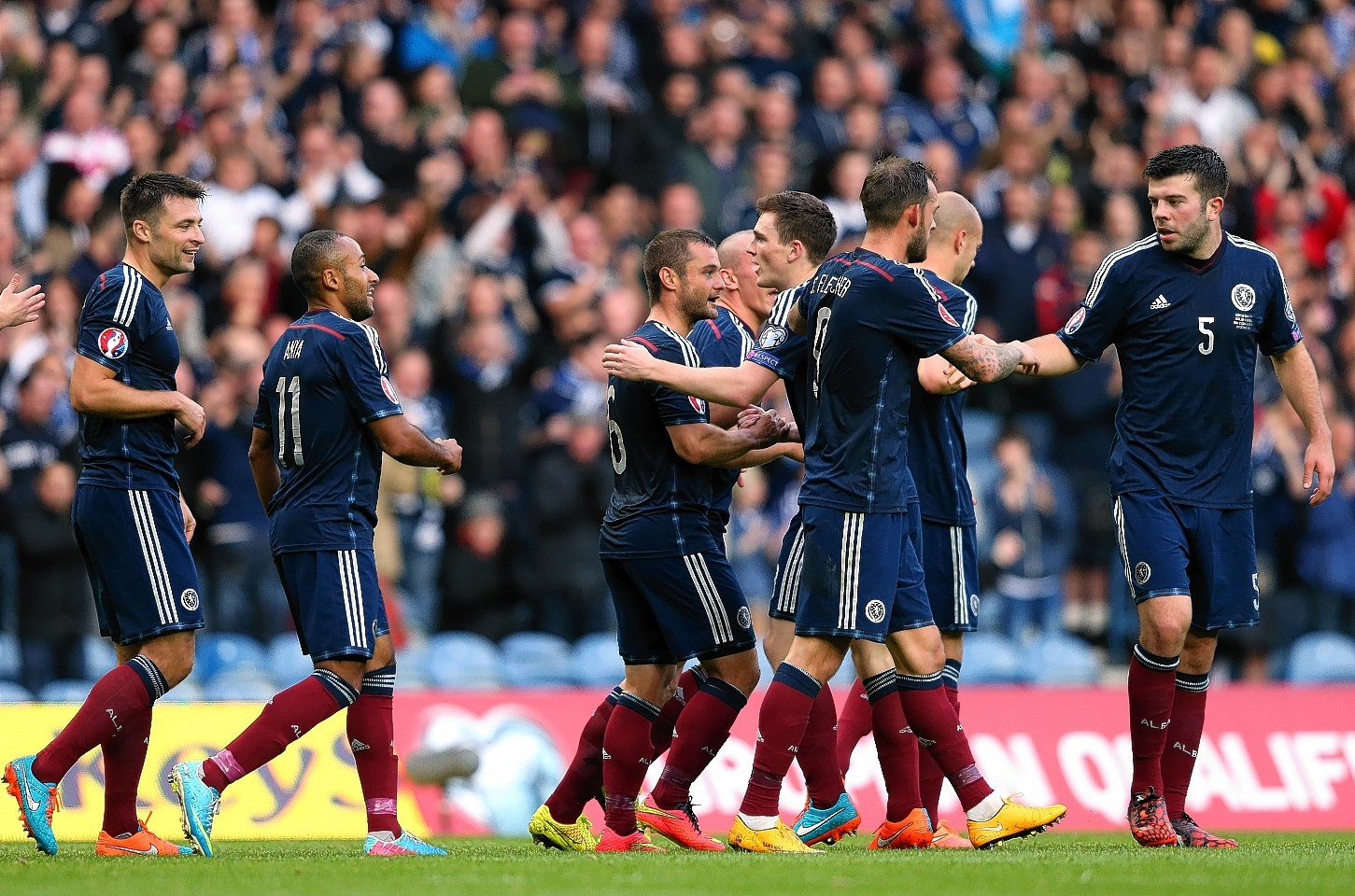 The Scotland players celebrate with Shaun Maloney after his shot resulted in the only goal of the game