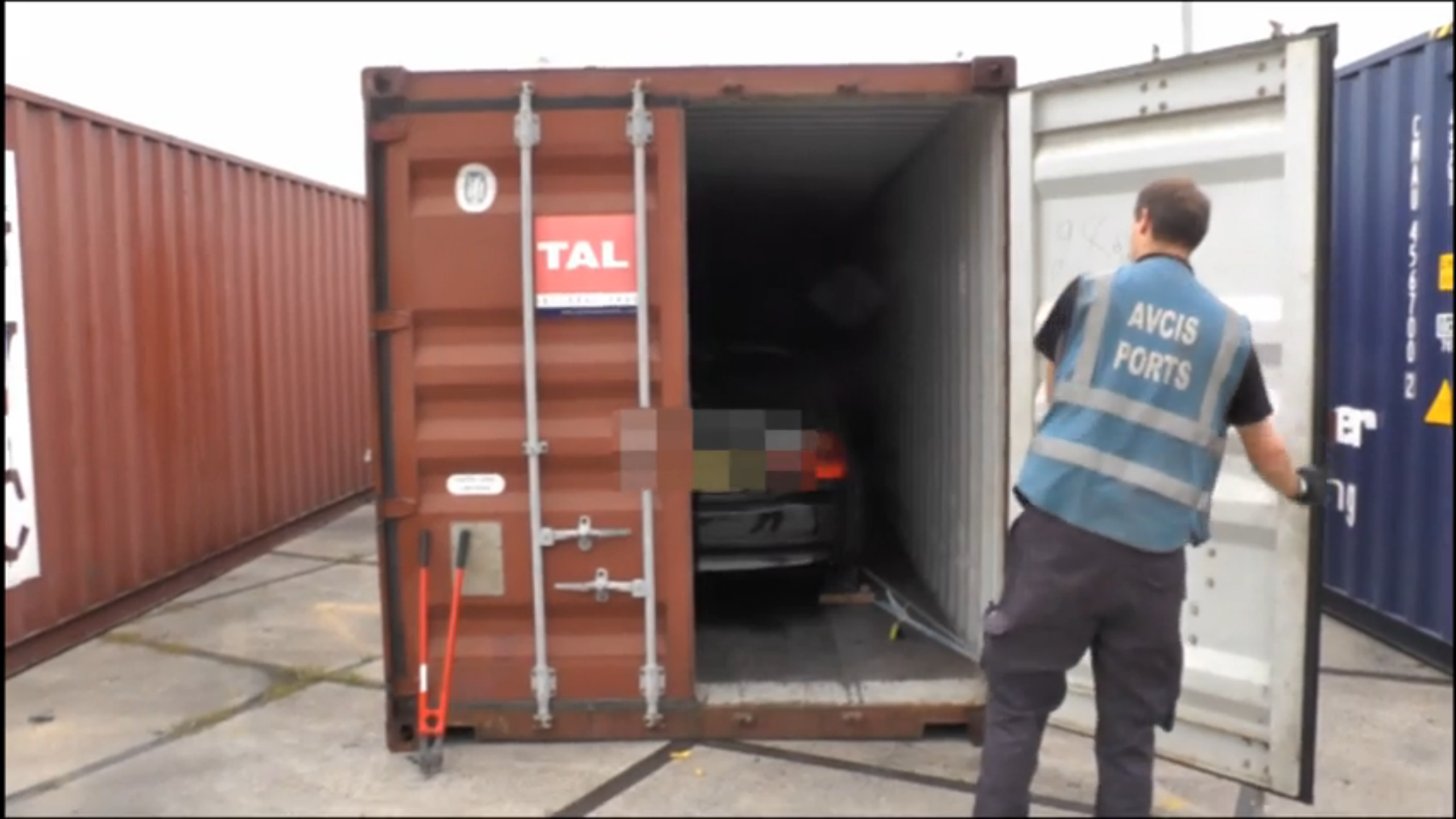 Officers show huge crates carrying the vehicles
