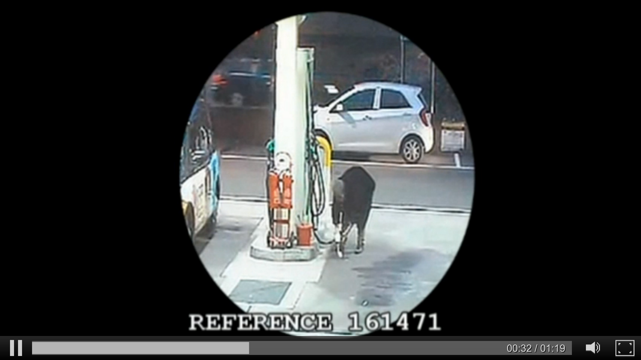 The man pours petrol on the floor of a filling station in London