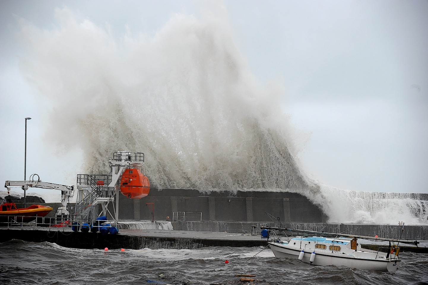 Waves batter Stonehaven Harbour wall yesterday