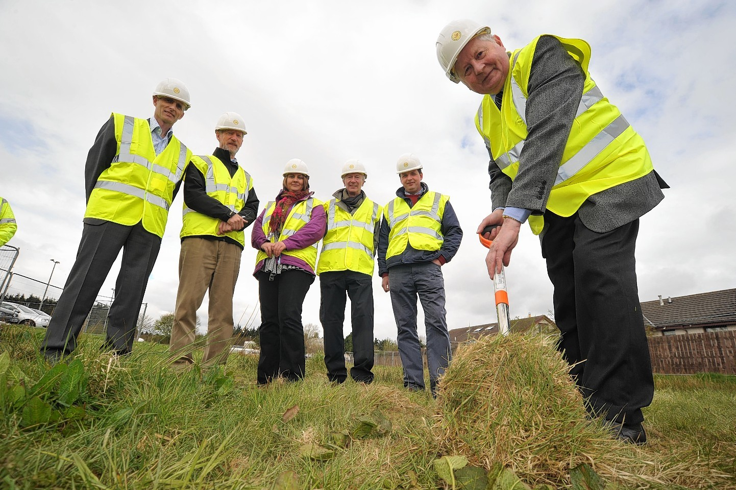 The cutting of the turf at the start of the project back in 2013