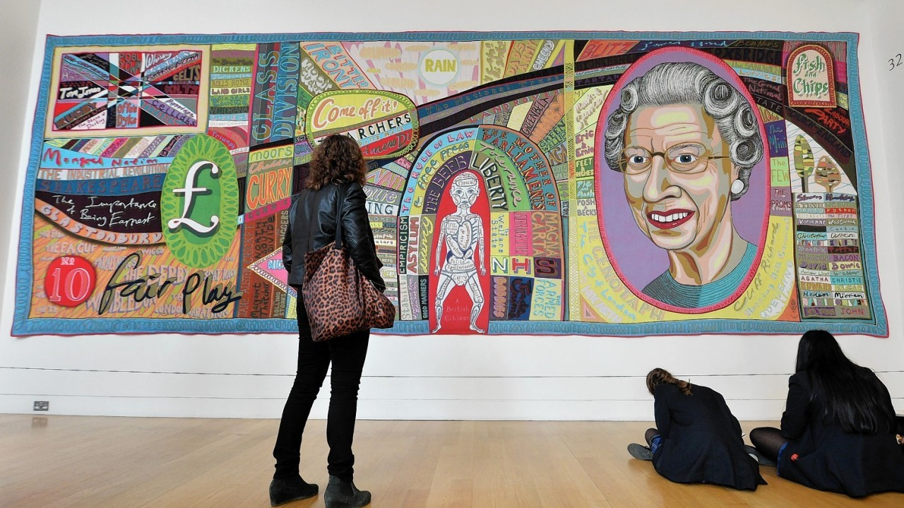 Visitors view 'Comfort Blanket' at the National Portrait Gallery