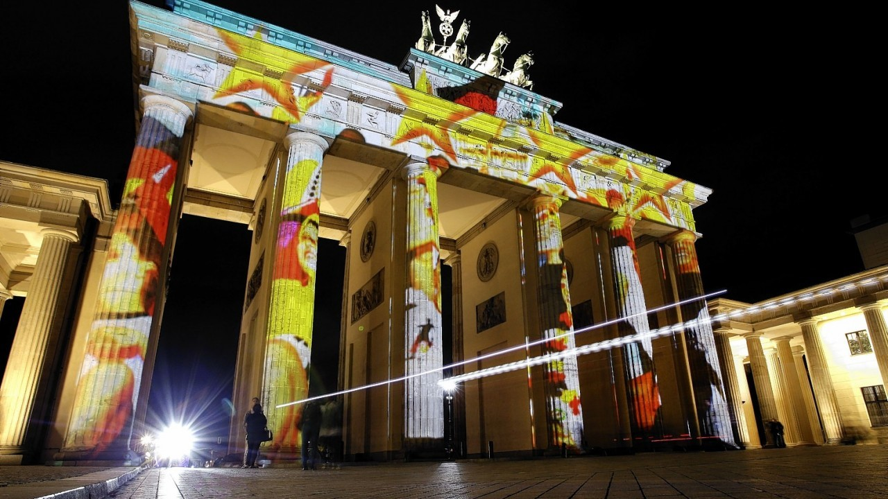 The Brandenburg Gate is illuminated on the eve of the official start of the 10th 'Festival of Lights' in Berlin