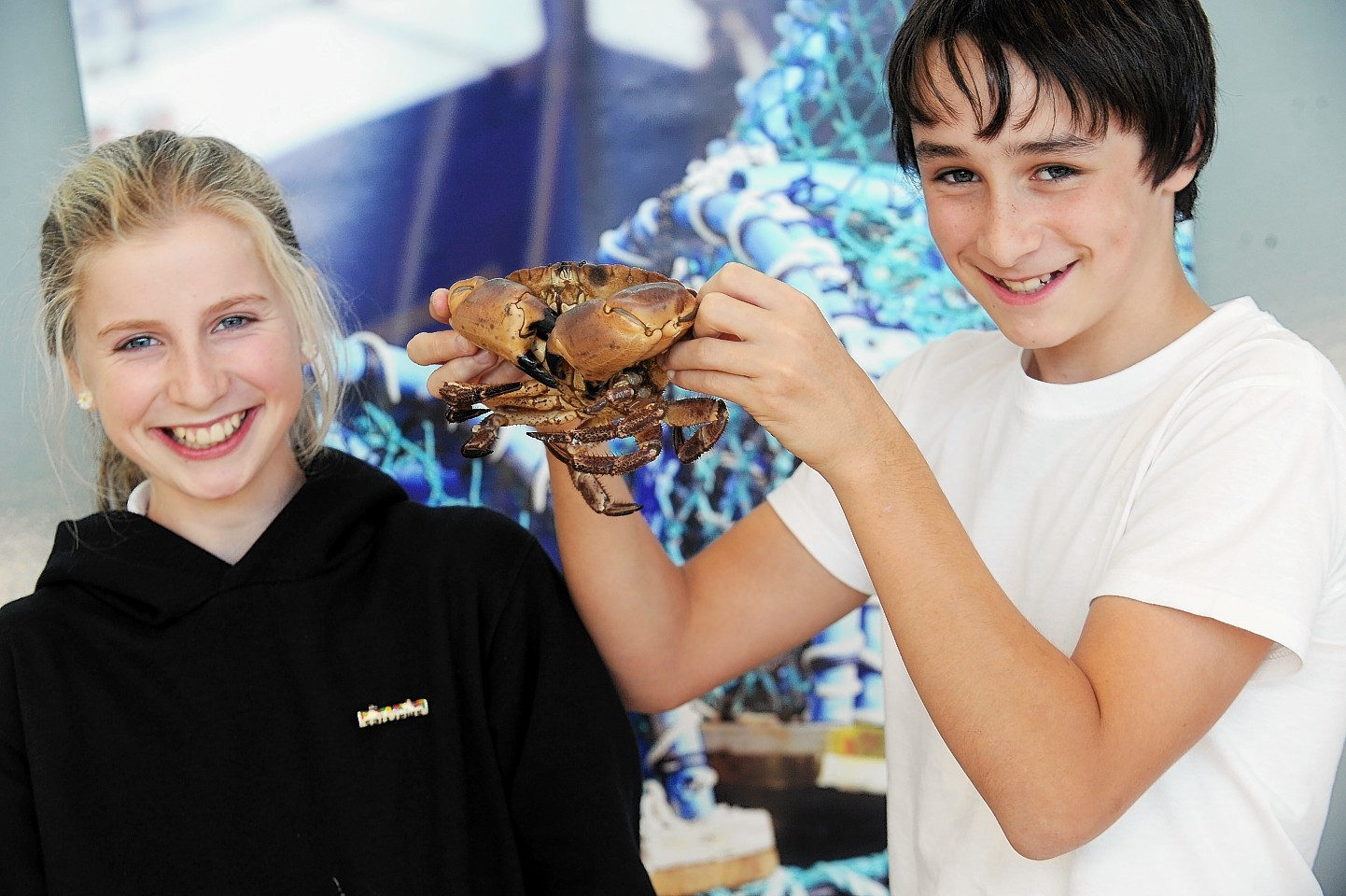 Fortrose Academy pupils Sarah Holden and James Thomson, both aged 12, with some of the seafood on show