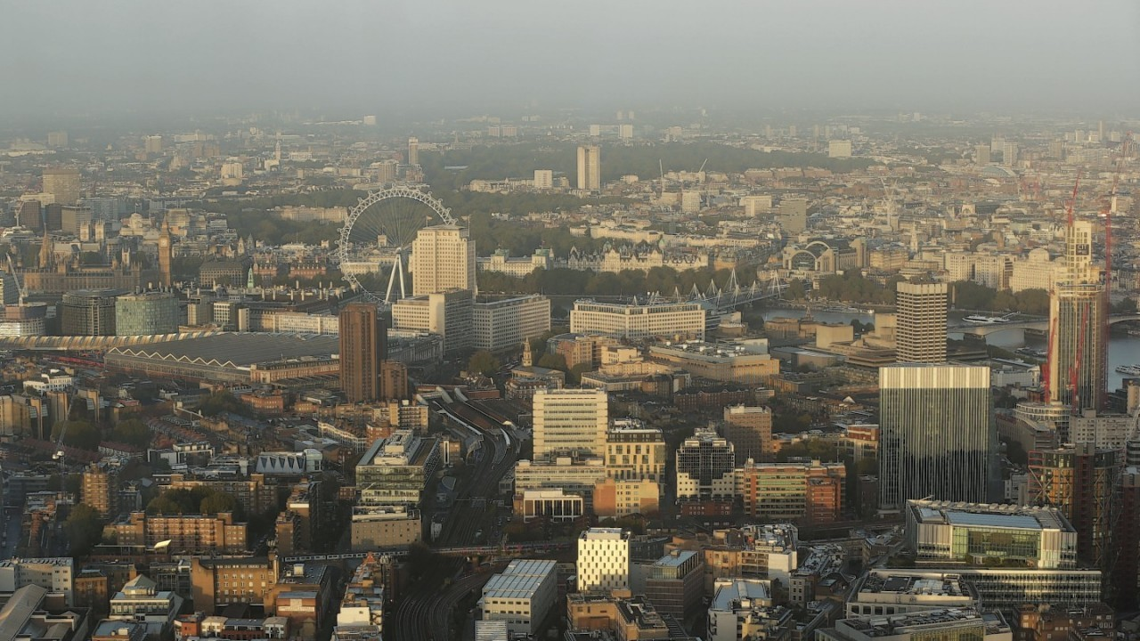A view of central London at sunrise from the top of The Shard building