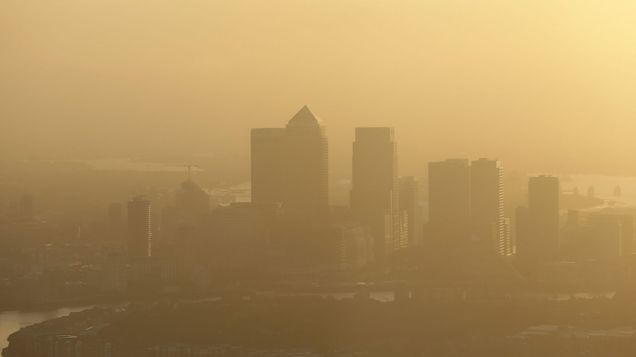 A view of Canary Wharf at sunrise in London from the top of The Shard building.