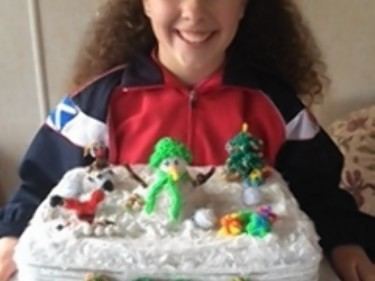 Dezzy Partington with her loom band cake