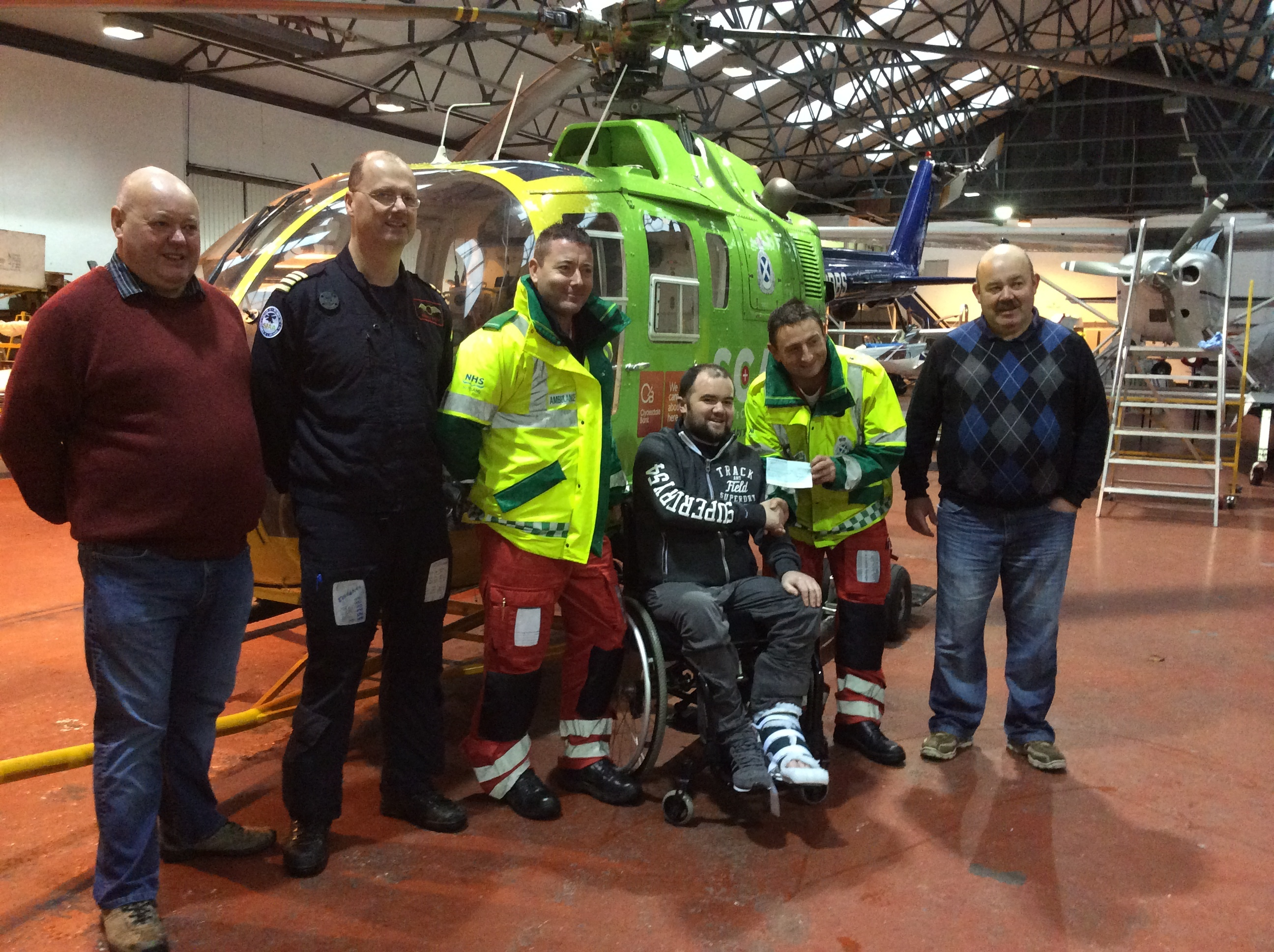 Grant Morrison with the men from Scotland's Air Ambulance Charity who flew him to ARI after his accident