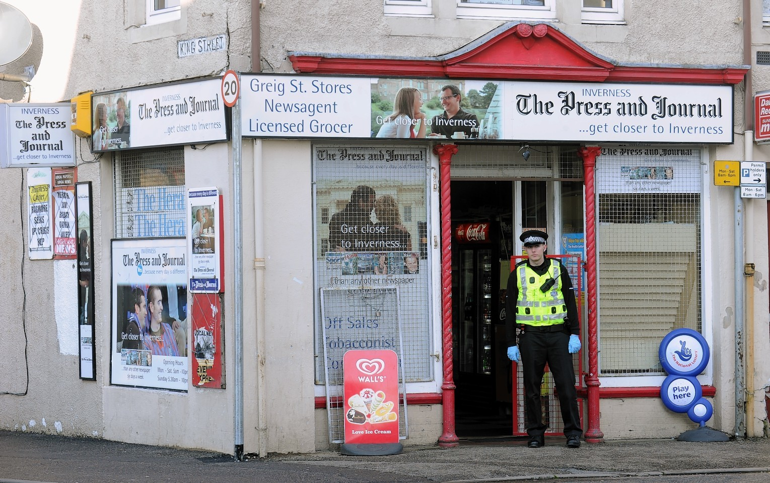 Police outside Greig Street Stores in Inverness