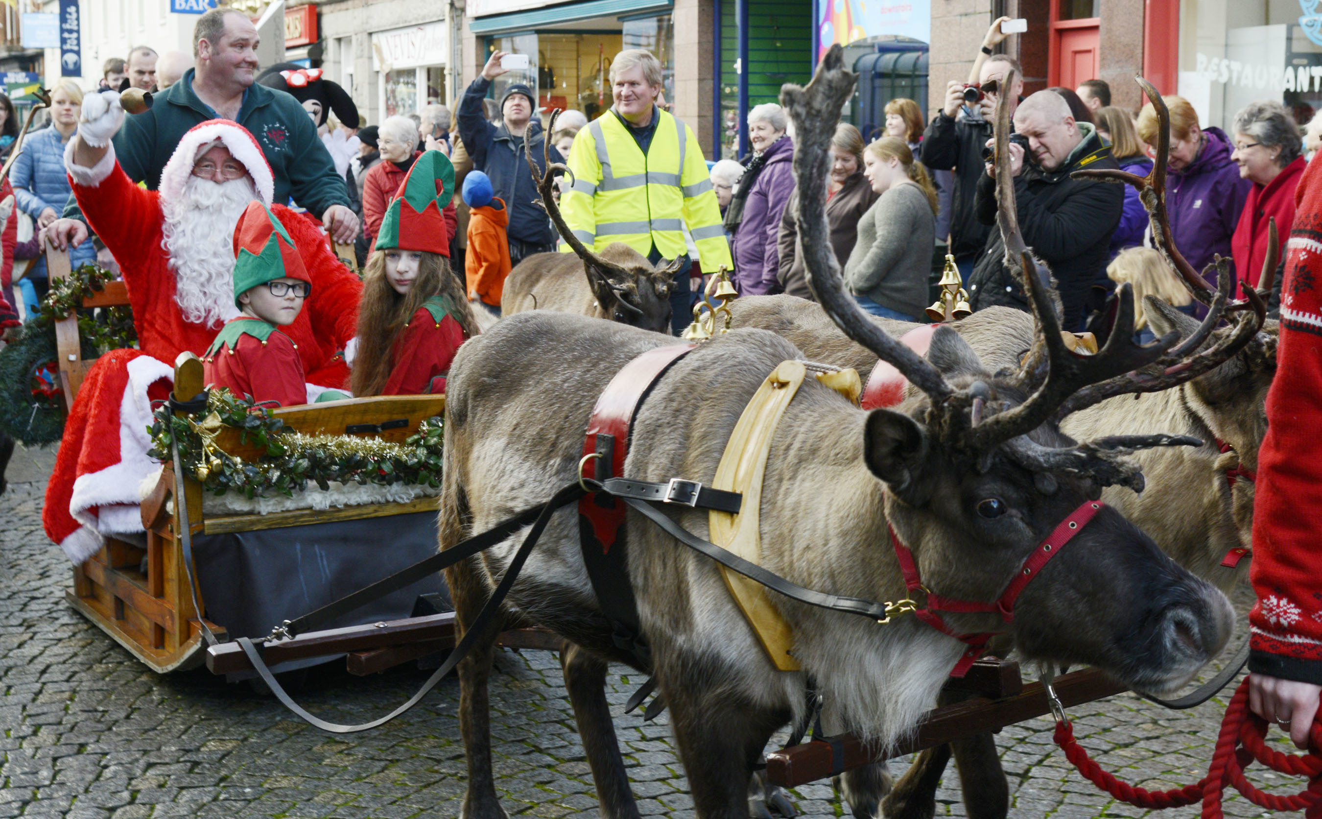 Santa and his reindeer delight the crowds in Fort William High Street
