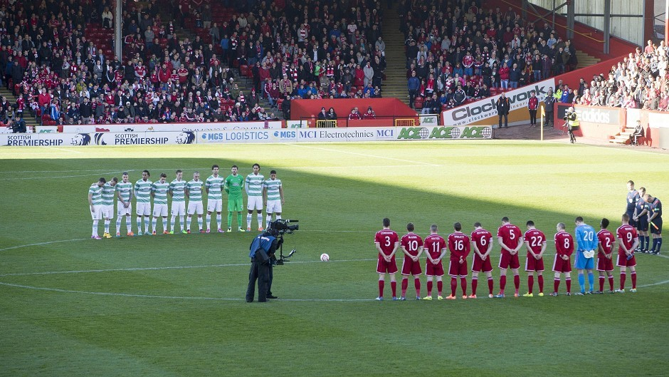 Aberdeen and Celtic players stand for the minute's silence for Remembrance Sunday