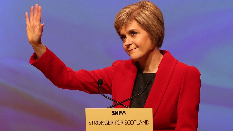 Newly appointed SNP leader Nicola Sturgeon gestures to the audience during her speech at the annual party conference at Perth Concert Hall, Scotland