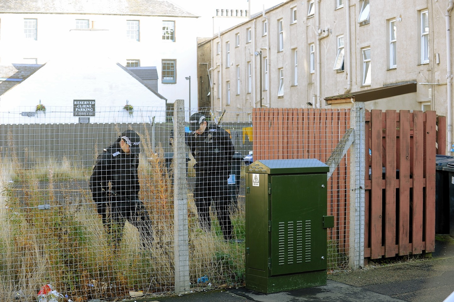Police look for evidence on Greg Street, Inverness
