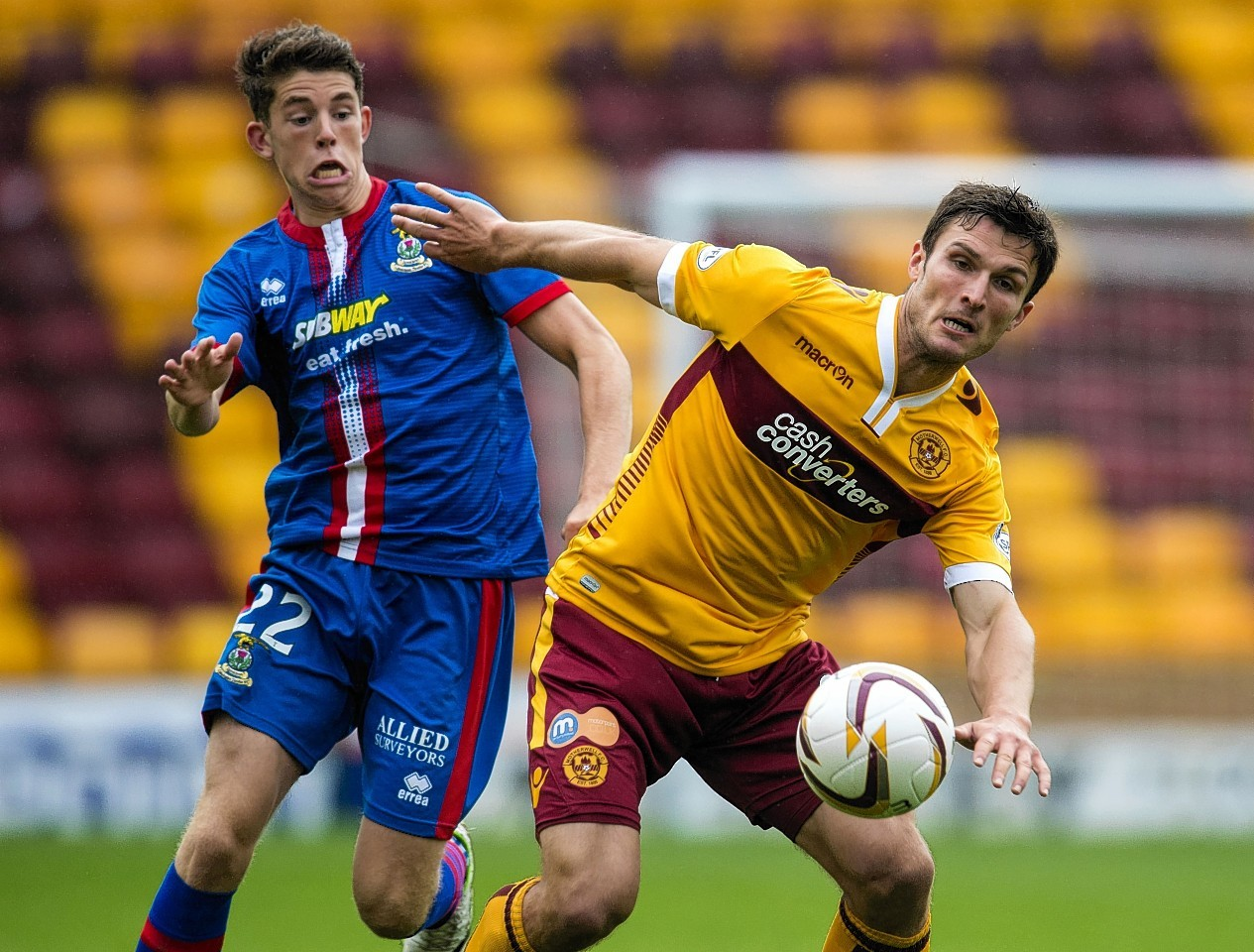 Ryan Christie and John Sutton challenge for the ball.