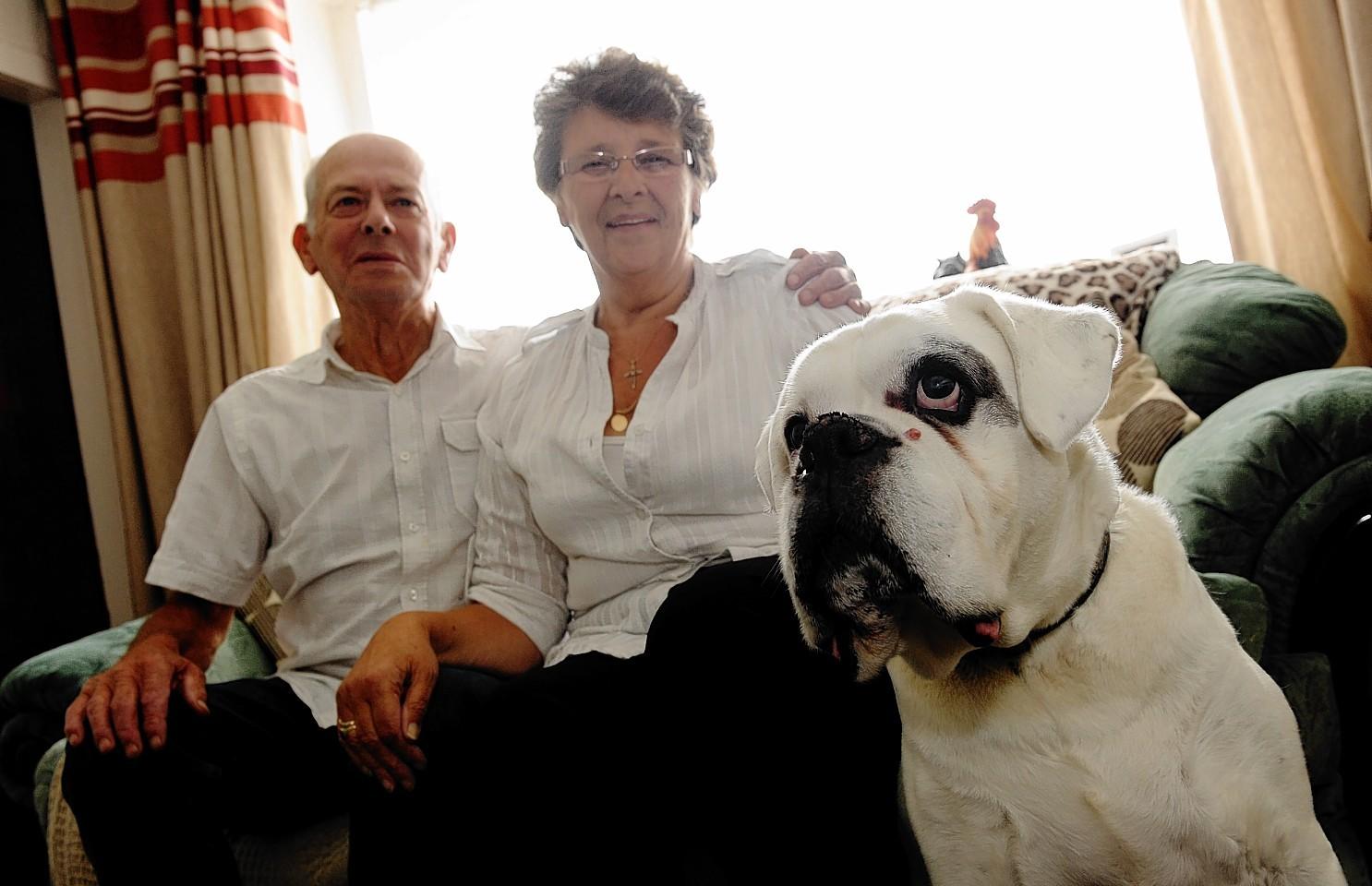 Irene with her husband John and dog Max