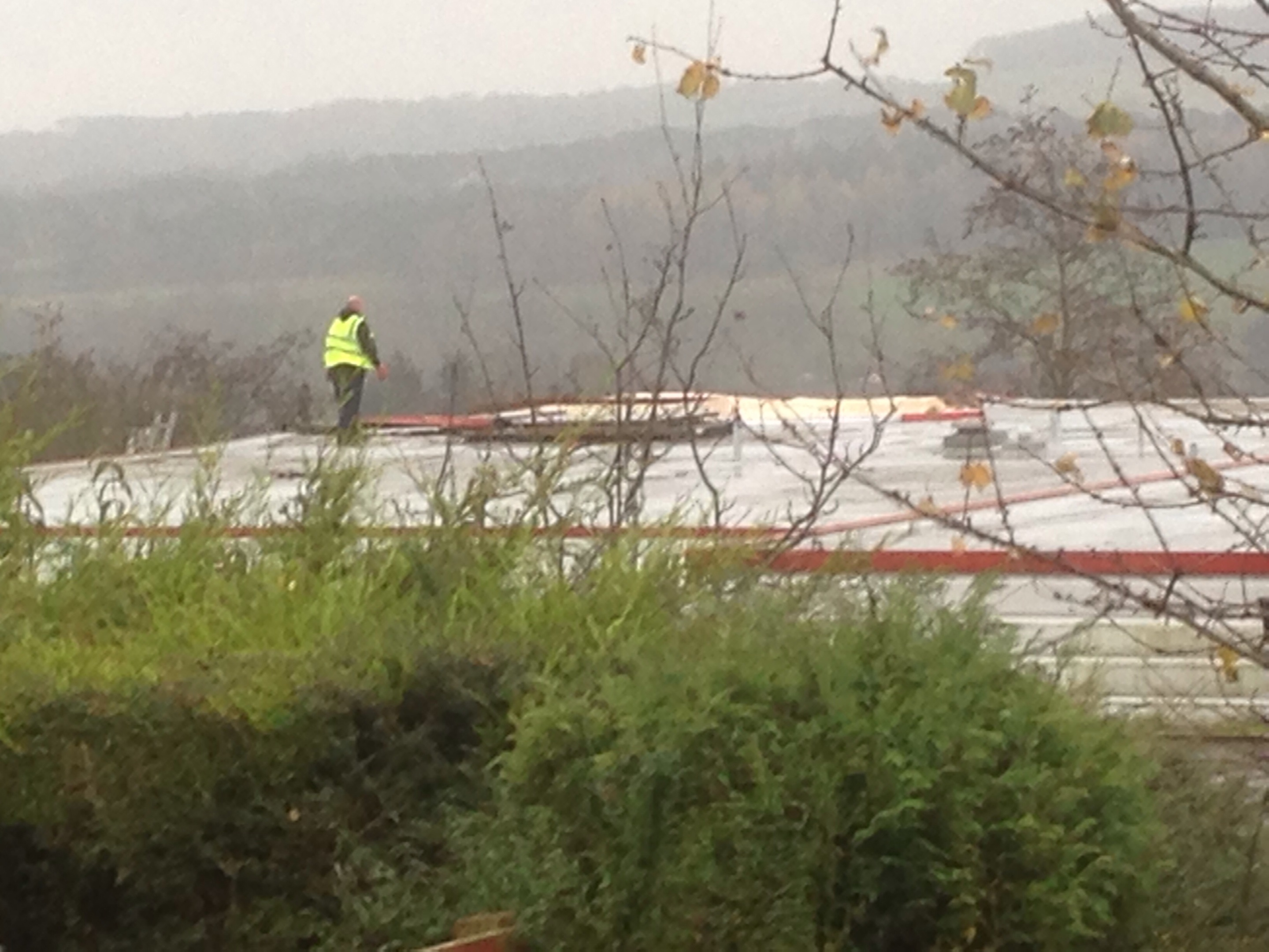 A worker on the damaged roof of Milltimber Primary School