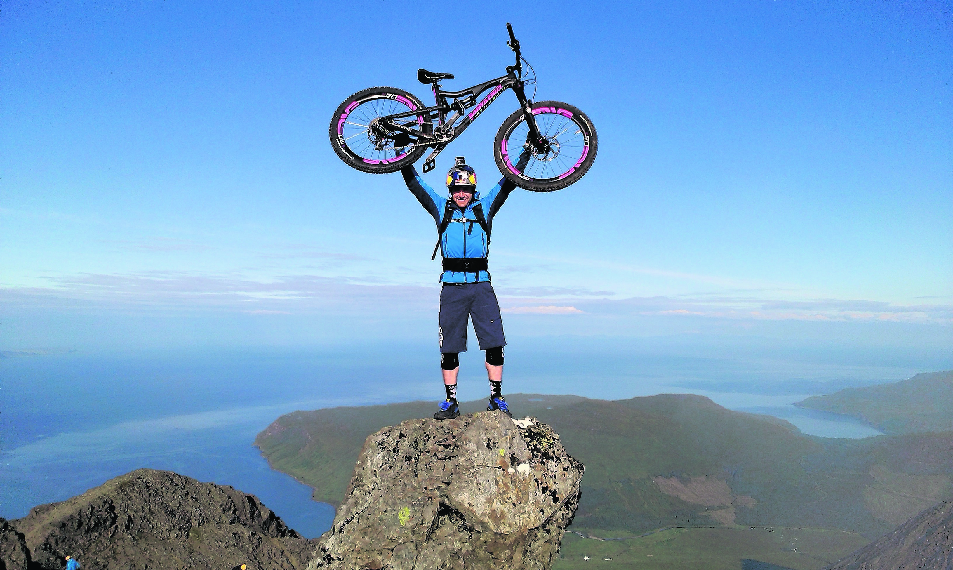 Cyclist Danny MacAskill on top of the Inaccessible Pinnacle in Skye