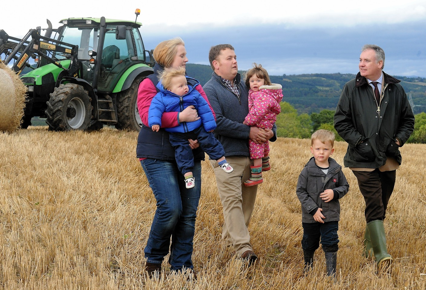Farm minister Richard Lochhead (right) with the Bennie family, who are tenants on the government's first starter farm at Balrobert Farm near Inverness.