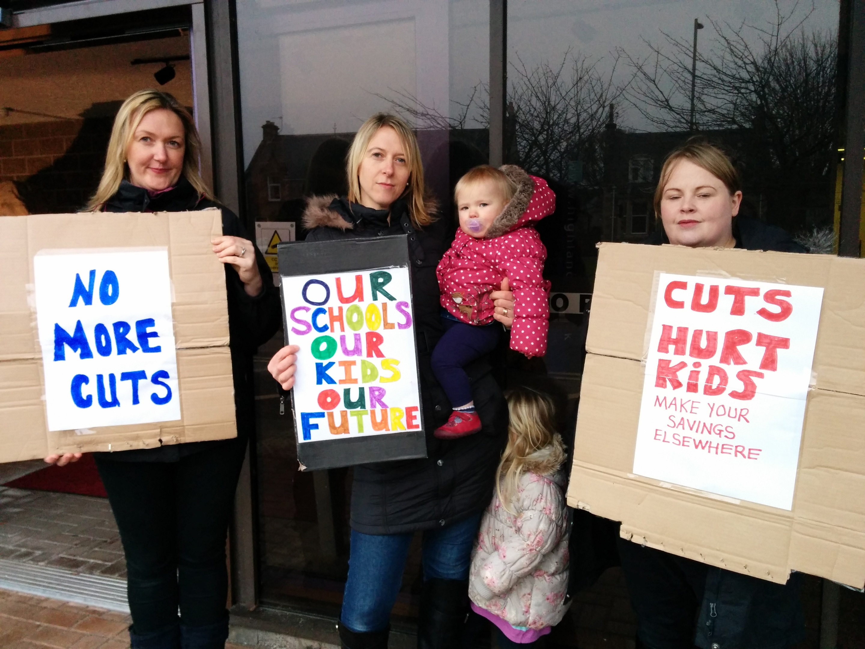 Muir of Ord mothers Tracy Underwood, Angela Budge and Natalie Shearer protest outside Highland Council's headquarters ahead of the local authority's budget meeting.