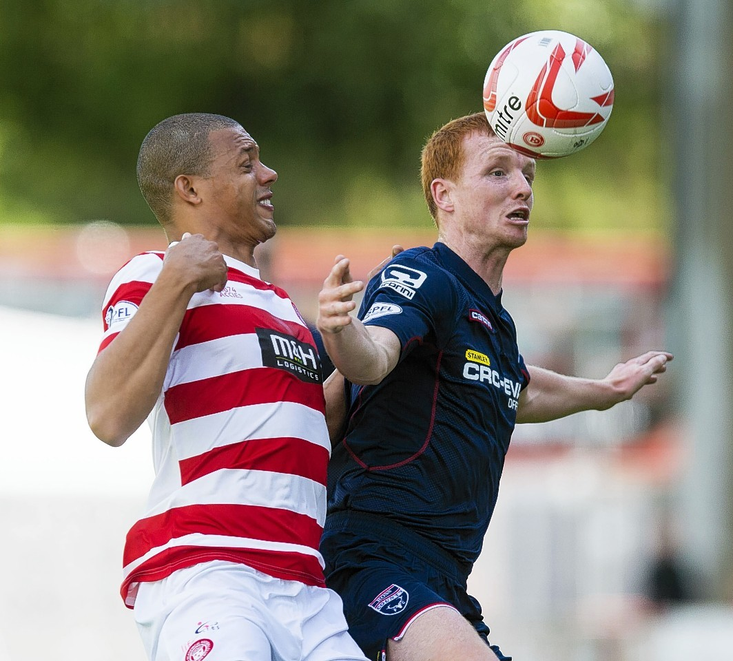 Scott Boyd has returned to Ross County's line-up for the last two matches.