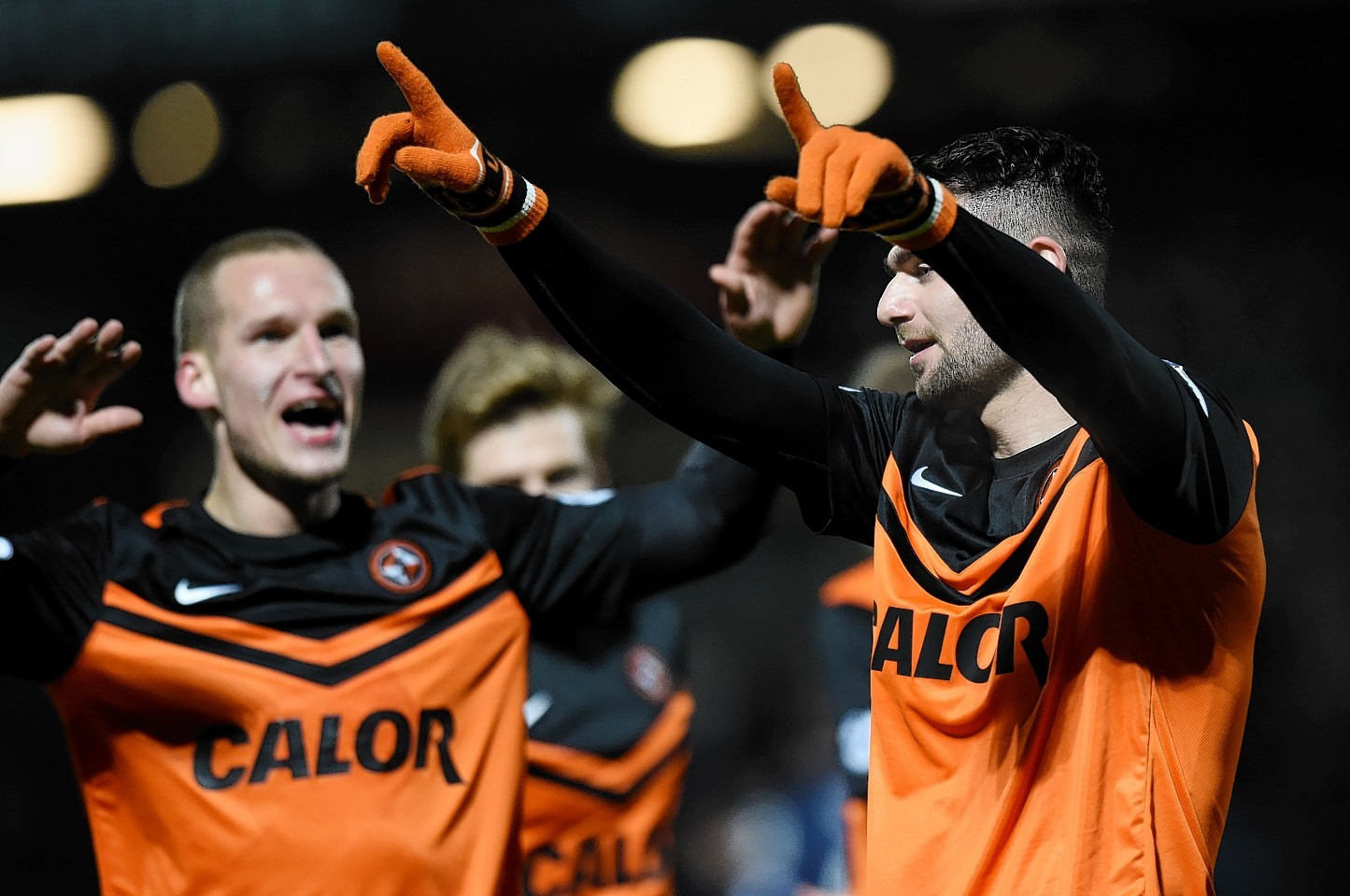 Nadir Ciftci celebrates netting a double against Ross County