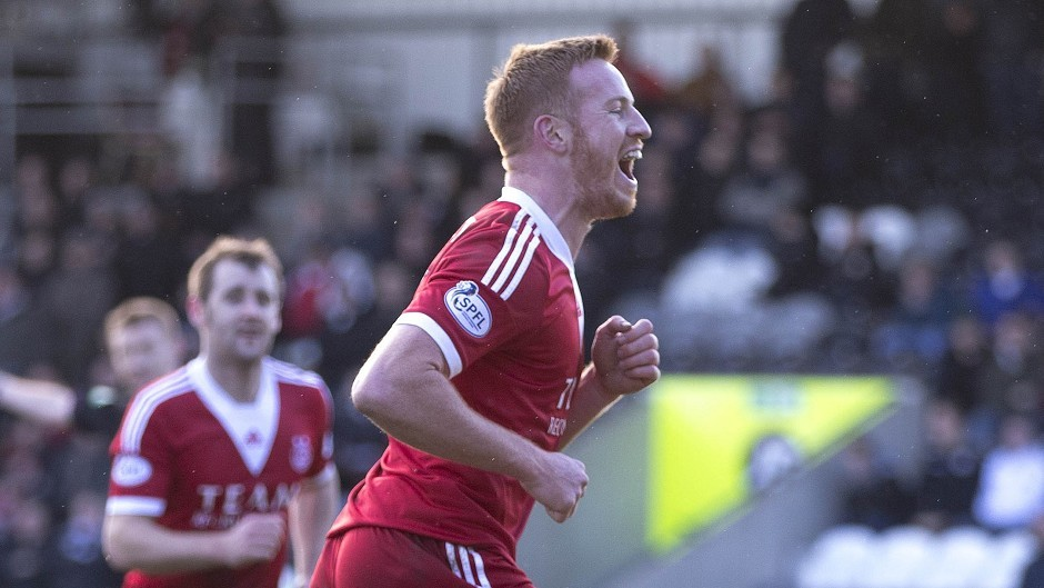 Aberdeen's Adam Rooney, left, was flying high against Dundee Utd with two goals