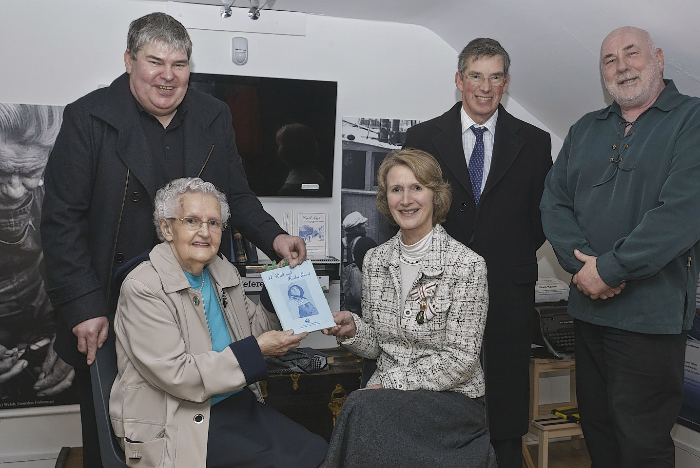 The family of the late Roy Souter, a staunch supporter of the museum, with Carol Kinghorn Lord Lieutenant of Kincardineshire and Viscount Arbuthnott. Mrs Lizzie Souter seated left and her son Jack behind.