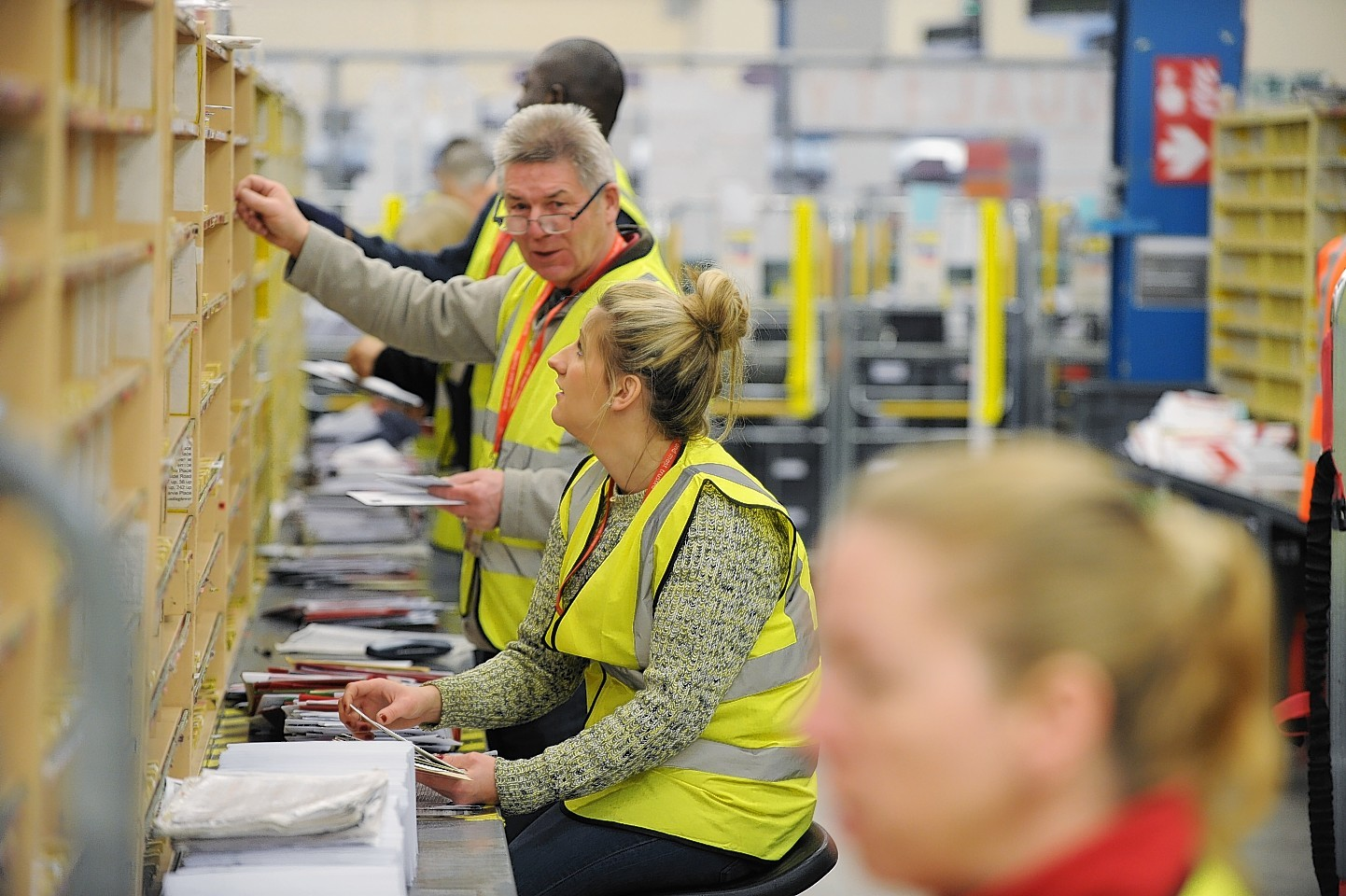 Royal Mail in Aberdeen sorting cards and parcels on the busiest day of the year for the organisation