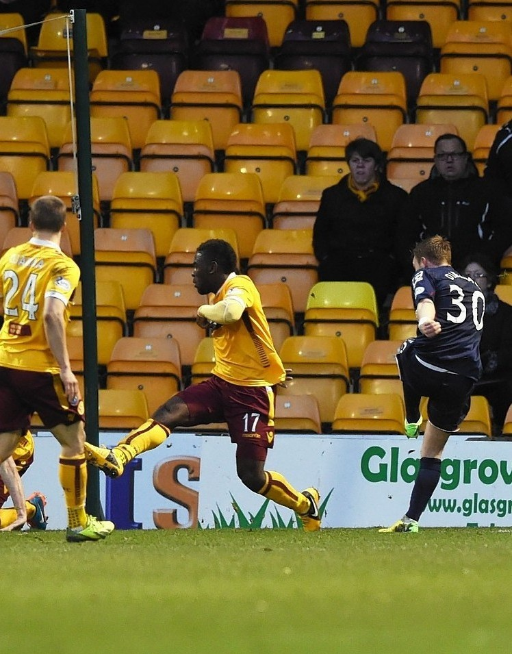 Tony Dingwall fires home his first goal, against Motherwell