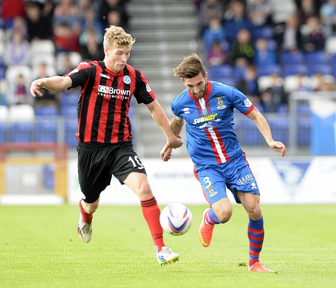 Graeme Shinnie takes on David Wotherspoon the last time Caley Thistle met St Johnstone