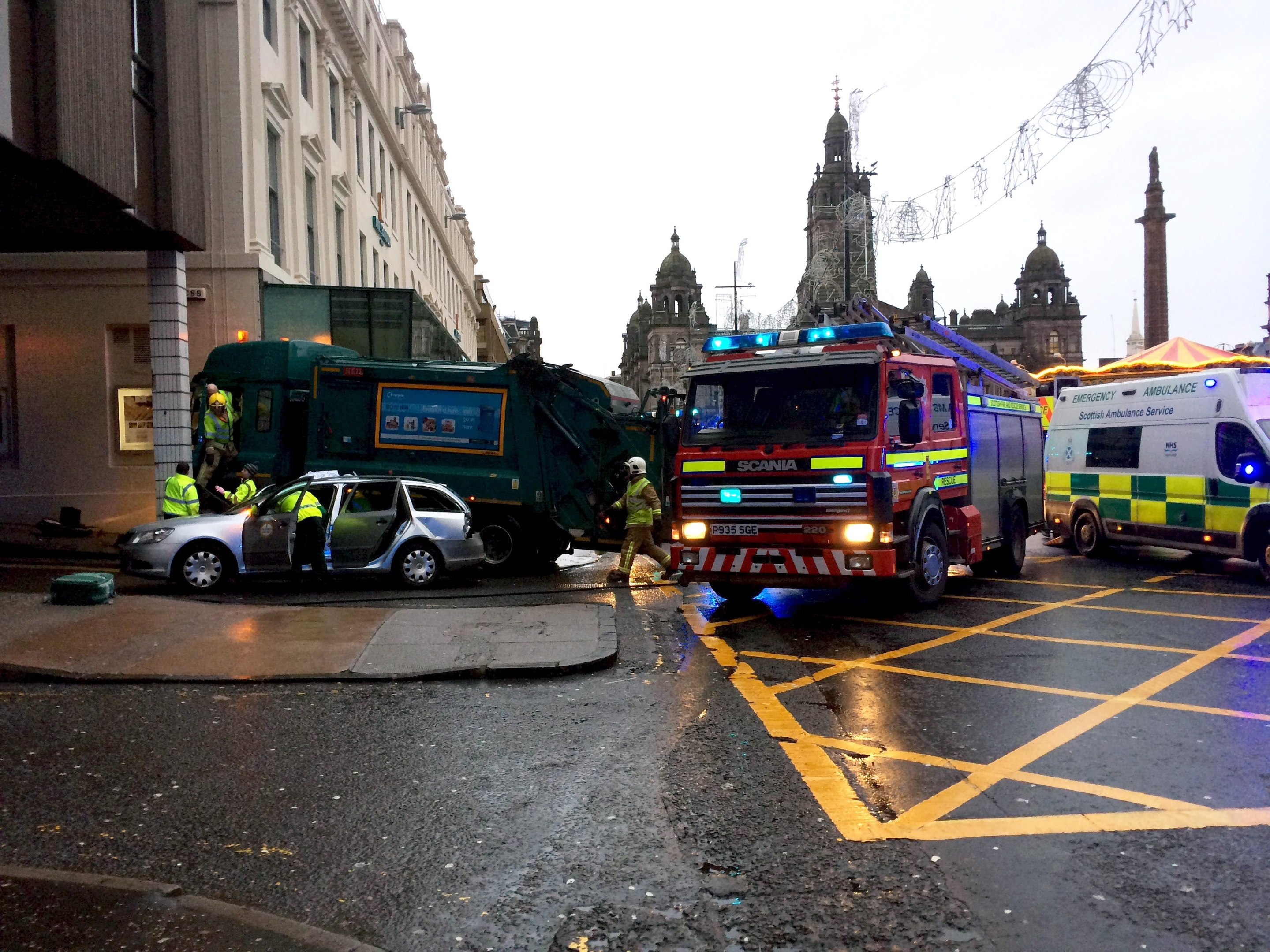 Emergency services at the scene on Queen Street in Glasgow where a bin lorry lost control and hit pedestrians, some are seriously injured with possible fatalities. December 22nd 2014