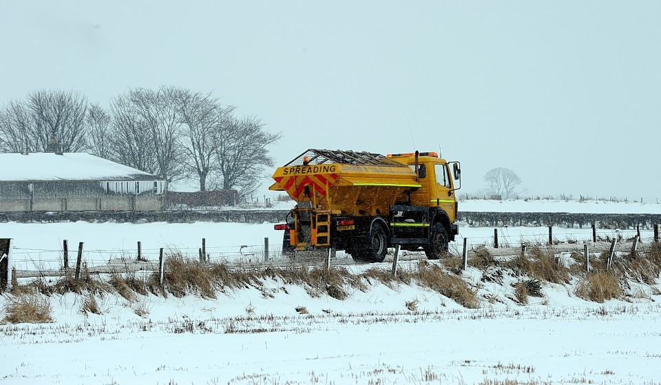 A gritter patrolling the roads