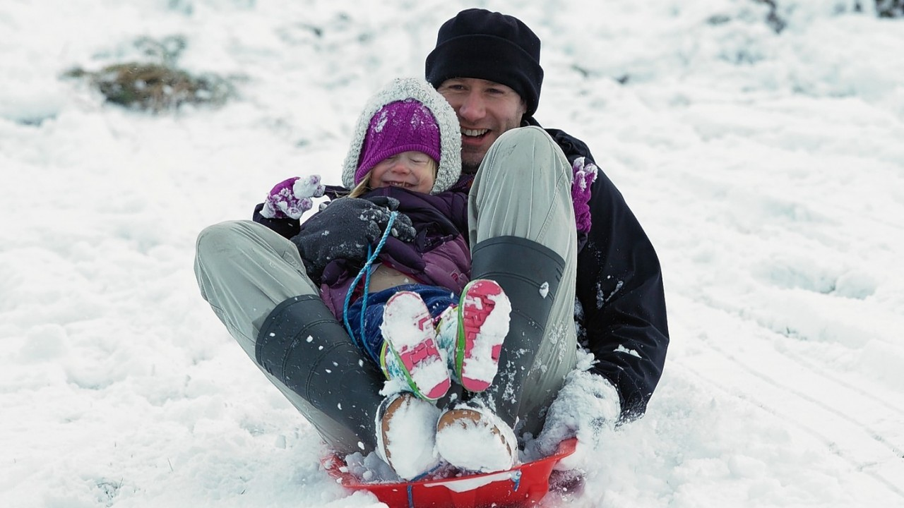 Stuart Thomson from Nairn makes the most of the snow above Aviemore 2 year old Iona.  Picture: Paul Campbell