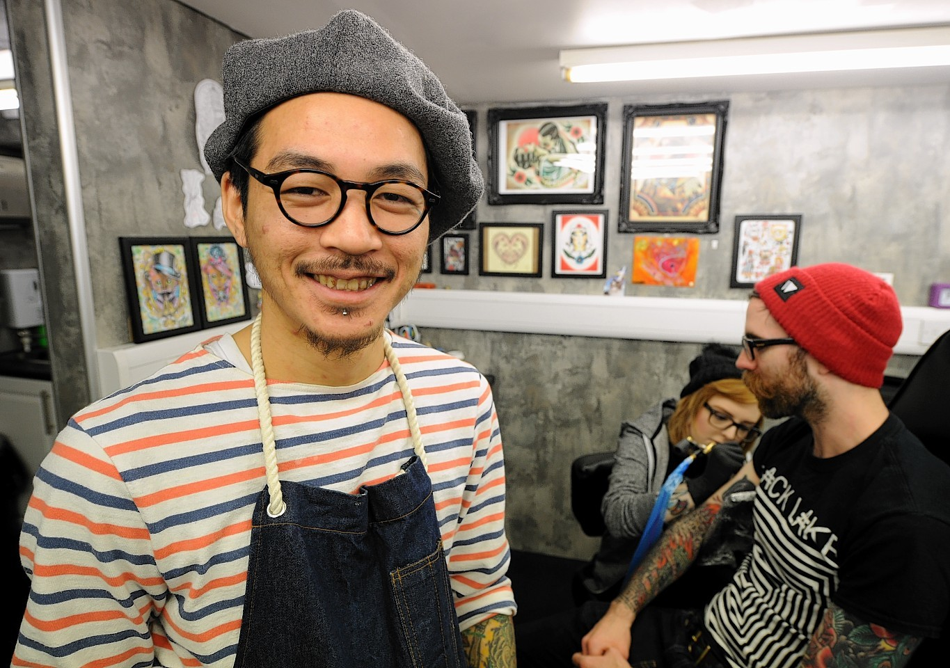Japanese tattoo artist Peco joins Rebel Ink for a week. Photo by Jim Irvine.