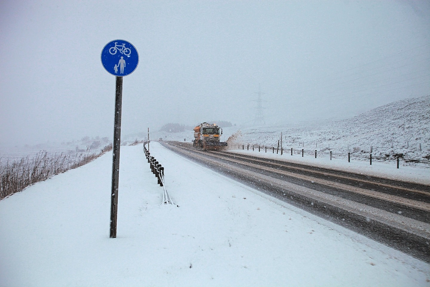 Snow lines the A9