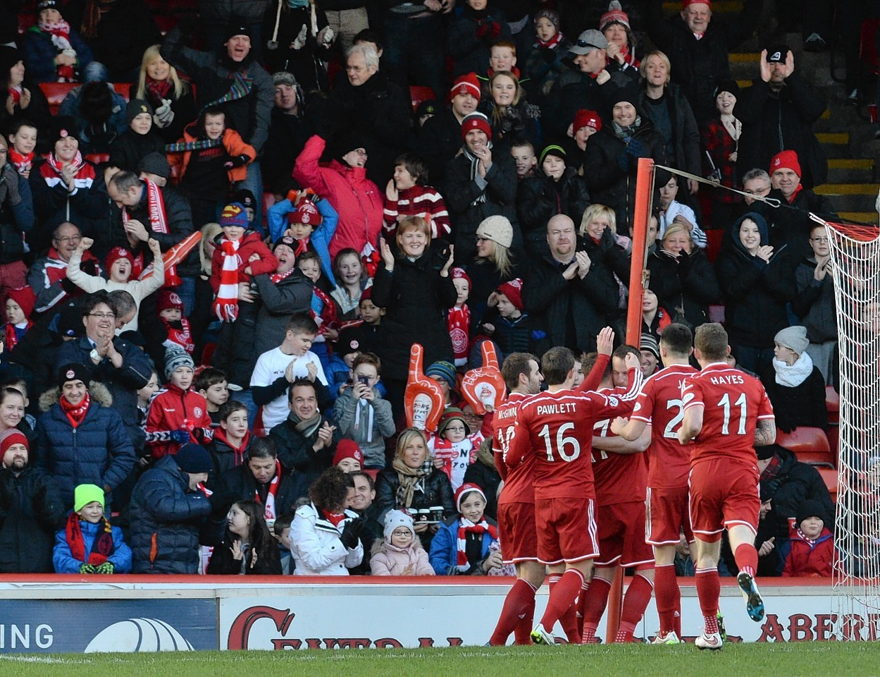 The Dons players and supporters celebrate David Goodwillie's goal