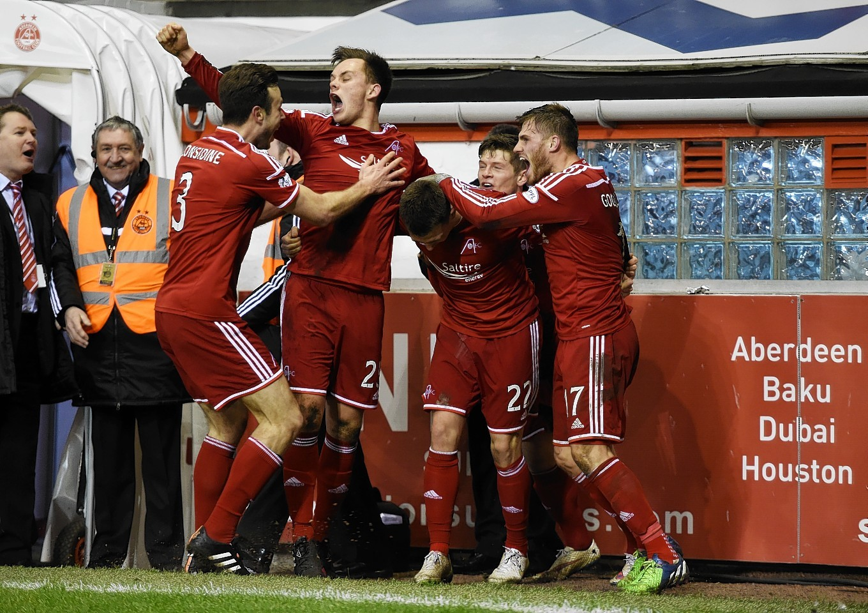 Aberdeen celebrate Jack's stoppage time goal