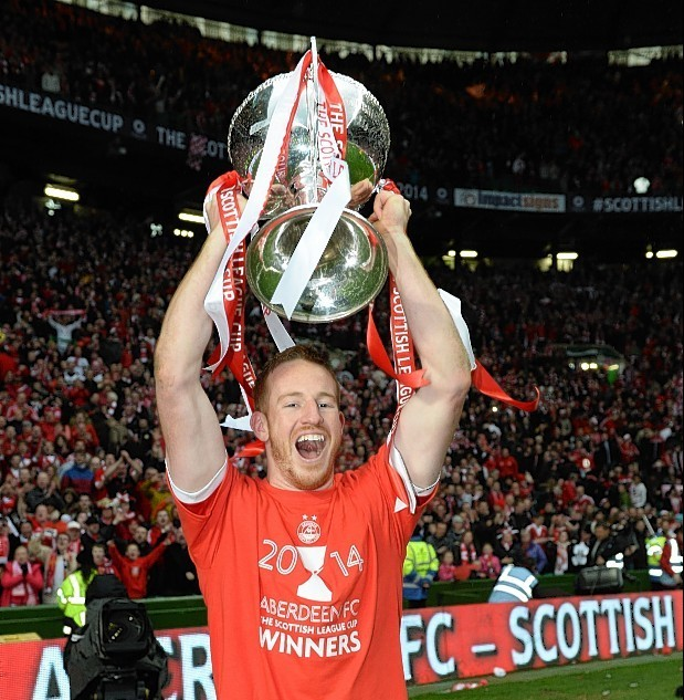 Adam Rooney shows his delight after winning the cup last season