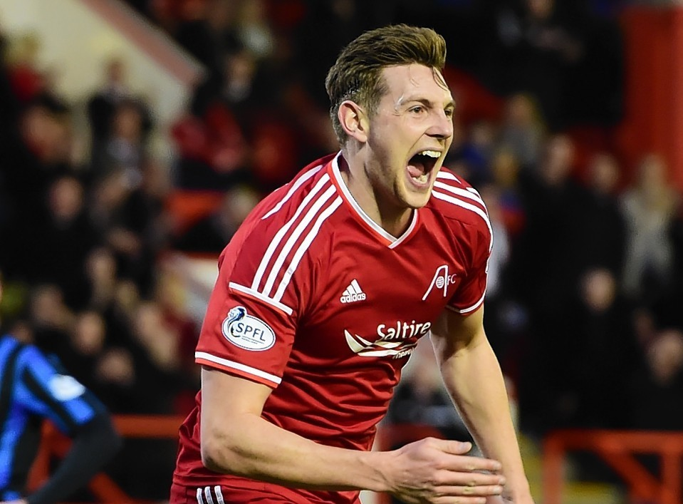 Taylor has formed a solid partnership with Mark Reynolds and yesterday committed to the Dons until 2017