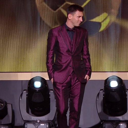 Lionel Messi and his purple suit