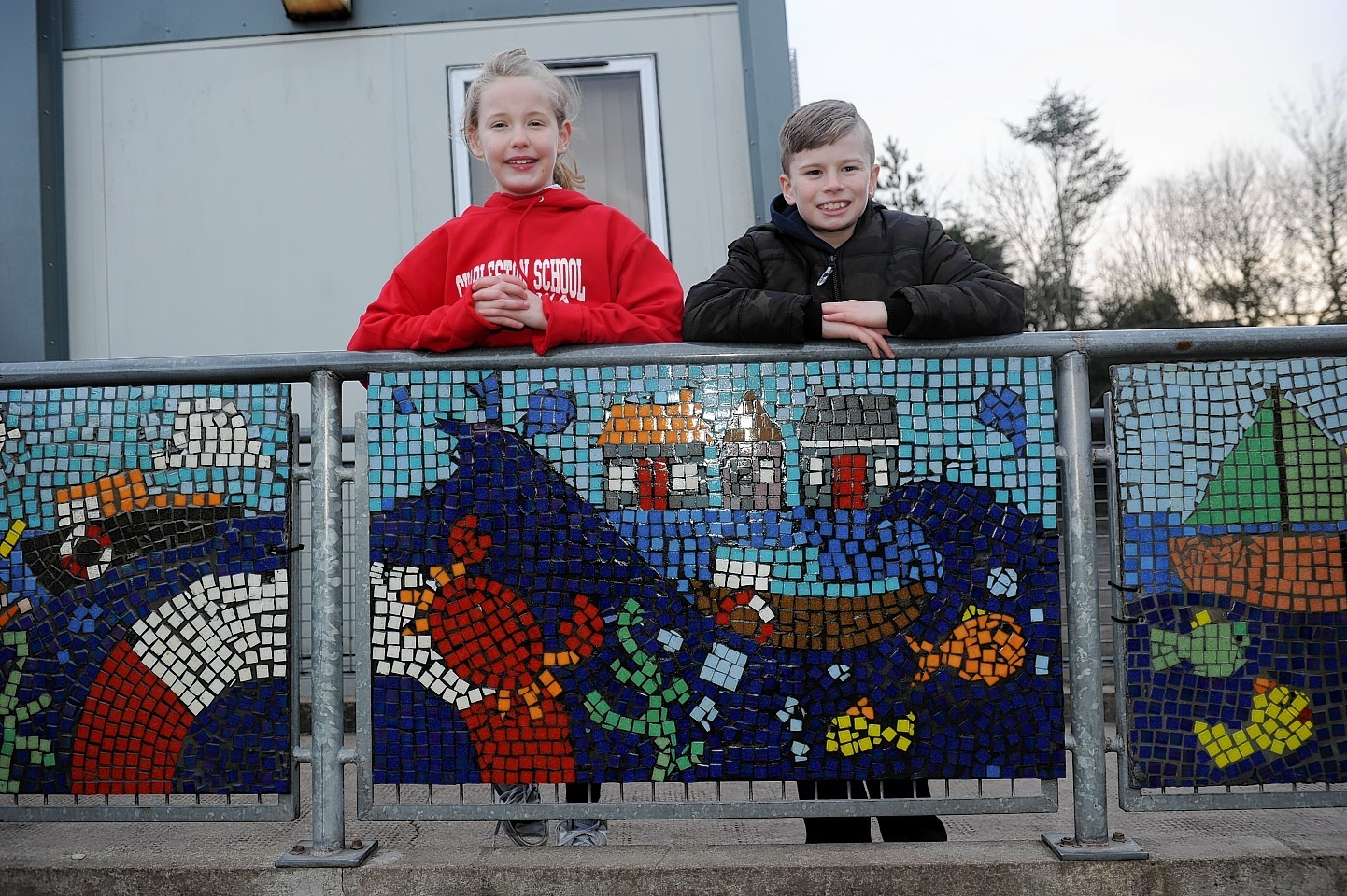 The pupils proudly display their masterpiece