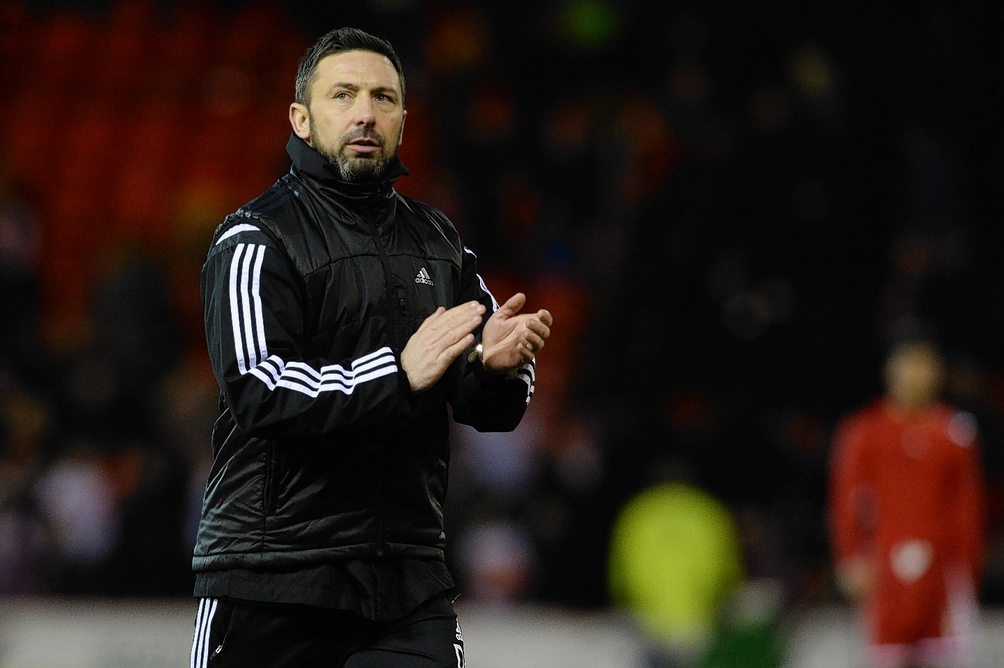 Derek McInnes applauds the home support after they helped spur the Dons on to a 3-3 draw.